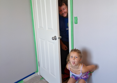 Being silly at Charlee's bedroom makeover by the brighter days foundation