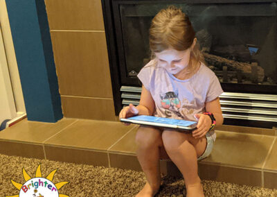 Charlee reviews the plans for her bedroom makeover by Brighter Days Foundation